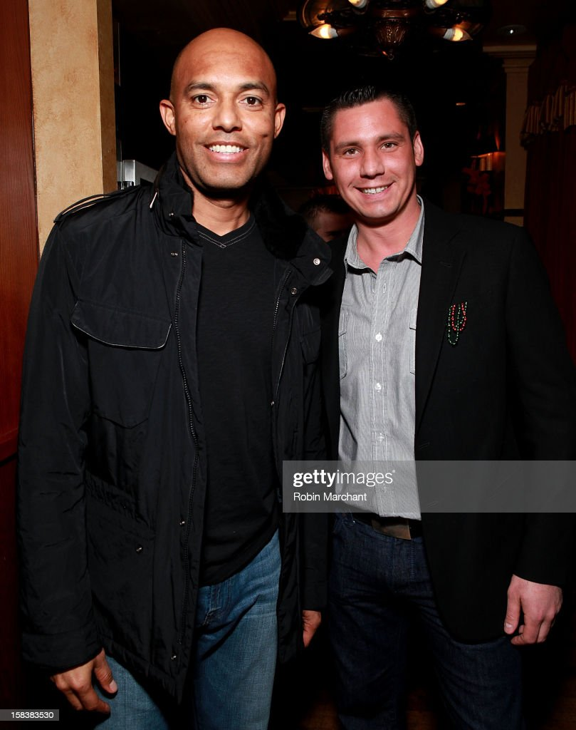 New York Yankees relief pitcher Mariano Rivera (L) and Alex Carr attend Elvis Duran Morning Show Holiday Party at Carmine's on December 14, 2012 in New York City.