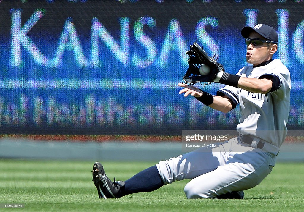 New York Yankees right fielder Ichiro Suzuki (31) makes a sliding catch for an out on Kansas City Royals' Mike Moustakas during the fifth inning at Kauffman Stadium in Kansas City, Missouri, Sunday, May 12, 2013.
