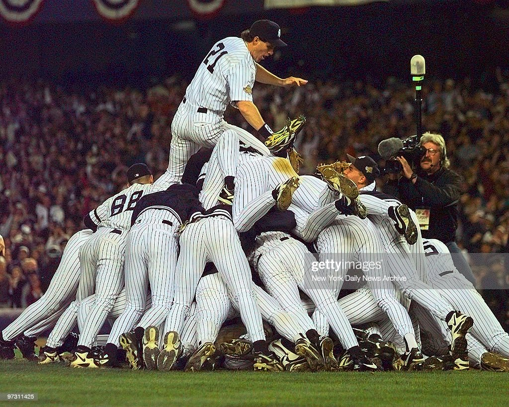 New York Yankees' right fielder Paul O'Neill tops the Yankees pileup at the end of game six of the 1996 World Series at Yankee Stadium The 32 win...