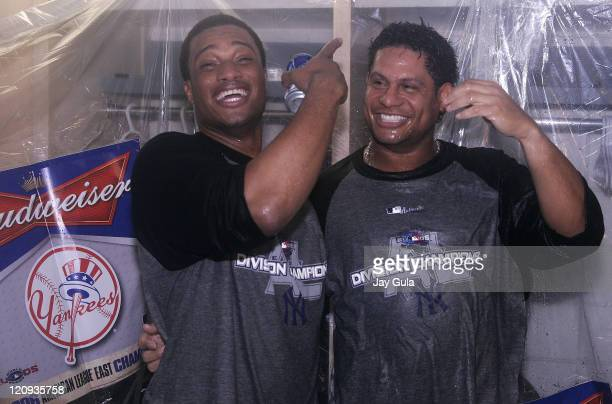 New York Yankees Robinson Cano and Bobby Abreu celebrate in their clubhouse after clinching their 9th consecutive American League East pennant The...