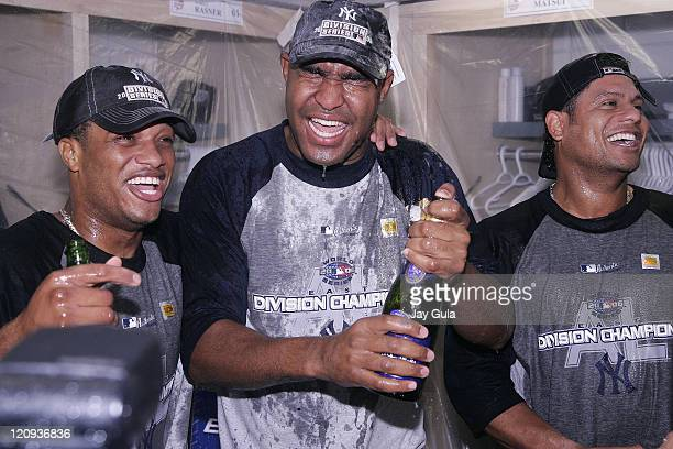 New York Yankees Robison Cano Jose Veras and Bobby Abreu celebrate in the clubhouse after clinching their 9th consecutive American League East...