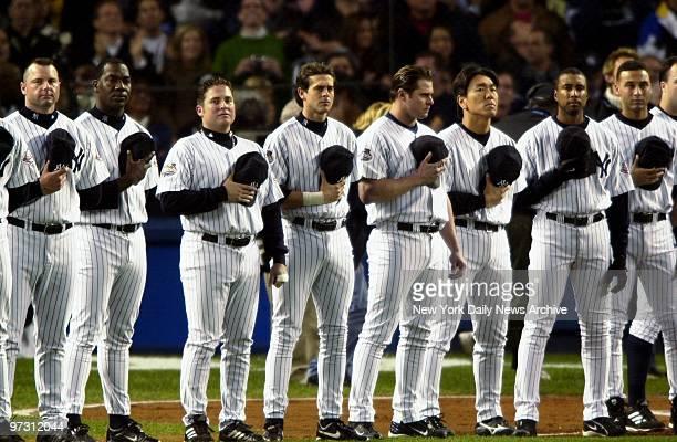 New York Yankees' Roger Clemens Jose Contreras Karim Garcia Aaron Boone Jason Giambi Hideki Matsui Bernie Williams and Derek Jeter holds their hats...