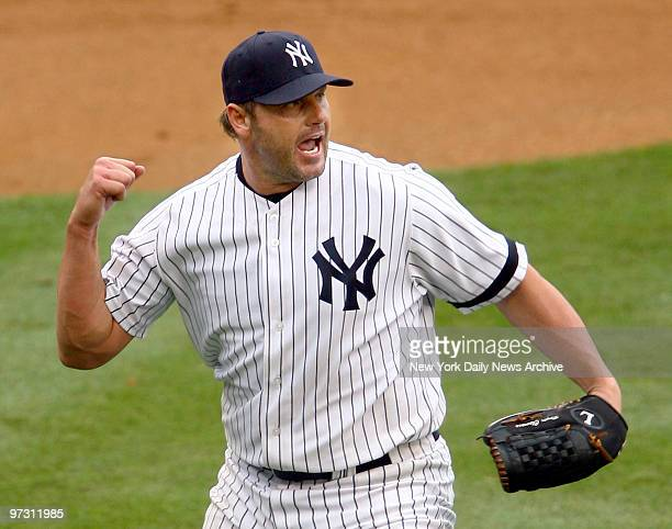 New York Yankees' Roger Clemens pumps his fist after throwing out the runner at first to retire the Pittsburgh Pirates in the second inning of a game...