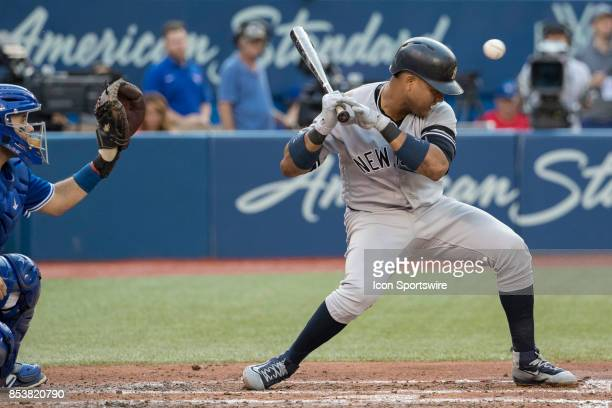 New York Yankees Second baseman Starlin Castro almost gets hit by a pitch during the regular season MLB game between the New York Yankees and the...