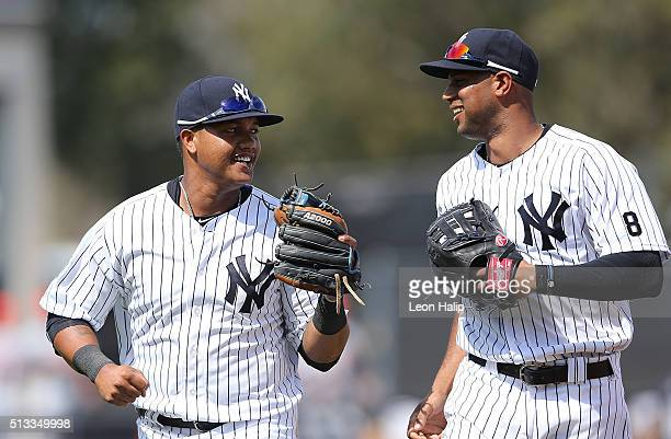 New York Yankees second baseman Starlin Castro and outfielder Aaron Hicks after the final out of the fourth inning of the Spring Training Game...