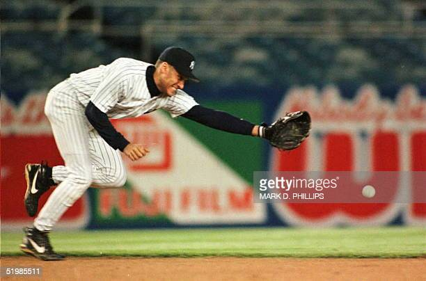 New York Yankees shortstop Derek Jeter grimaces as a ground ball hit by Detroit Tigers Chad Curtis gets past in the third inning 06 May The hit...