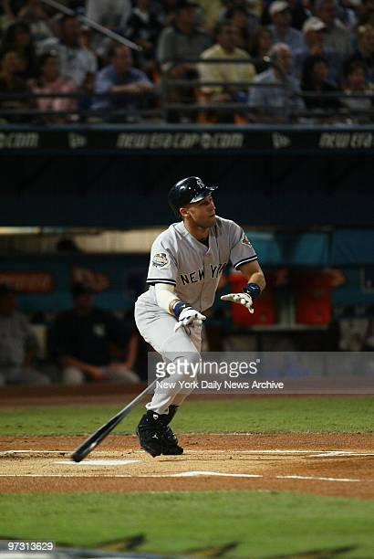 New York Yankees' shortstop Derek Jeter leads off the game with a single to right field in the first inning of Game 5 of the World Series against the...