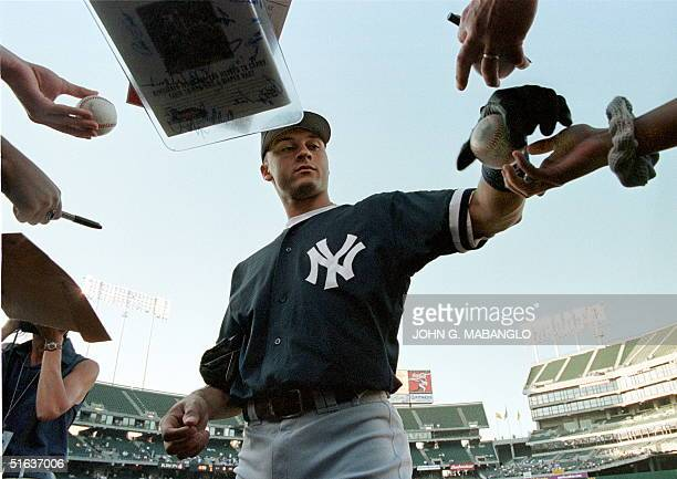 New York Yankees shortstop Derek Jeter takes time to sign autographs before a game against the Oakland Athletics 05 August in Oakland CA The...