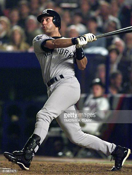 New York Yankees' shortstop Derek Jeter watches his home run in the 6th inning of Game Five of the World Series against the New York Mets at Shea...