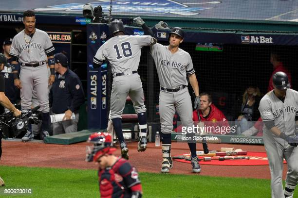 New York Yankees shortstop Didi Gregorius and New York Yankees first baseman Greg Bird celebrate after Gregorius hit a home run during the first...