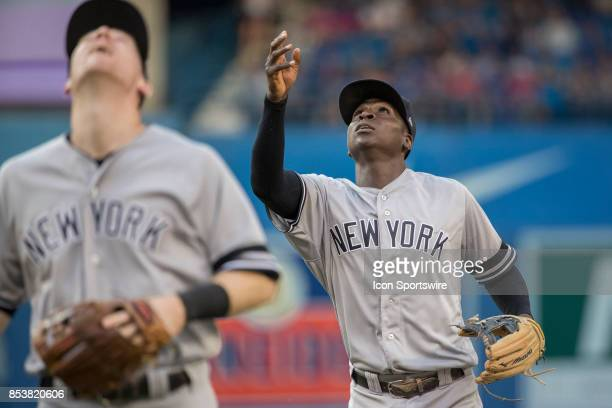 New York Yankees Shortstop Didi Gregorius right tosses a ball up to the fans during the regular season MLB game between the New York Yankees and the...