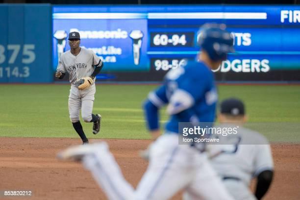 New York Yankees Shortstop Didi Gregorius throws to teammate First baseman Greg Bird to get Toronto Blue Jays Centre Fielder Kevin Pilar out during...