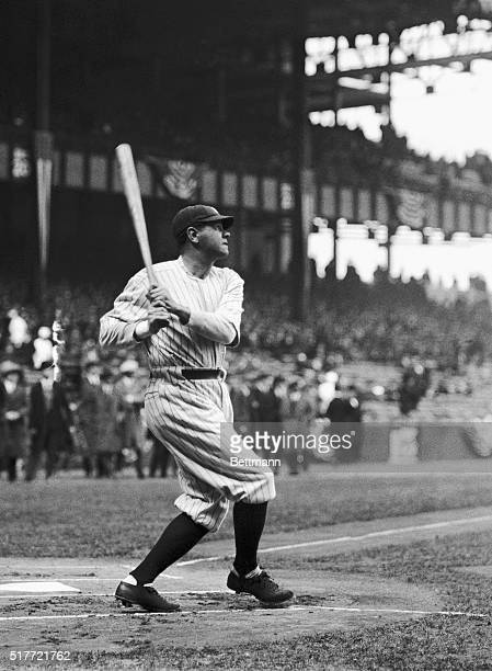 New York Yankees slugger Babe Ruth watches a towering drive of his sail towards the outfield wall