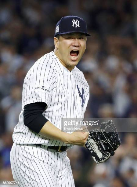 New York Yankees starter Masahiro Tanaka gets out of a pinch during the fifth inning of the American League Championship Series Game 5 against the...