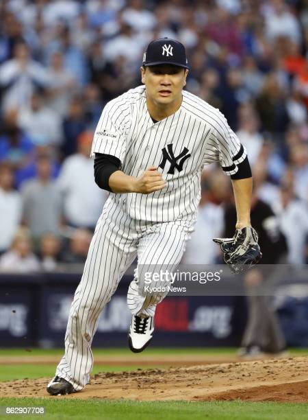 New York Yankees starter Masahiro Tanaka runs to cover the first base during the third inning of the American League Championship Series Game 5...