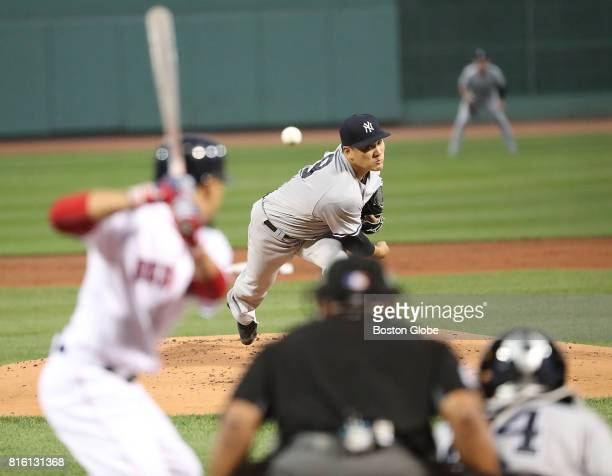 New York Yankees starting pitcher Masahiro Tanaka delivers a pitch against Boston Red Sox Mookie Betts during first inning action during the second...