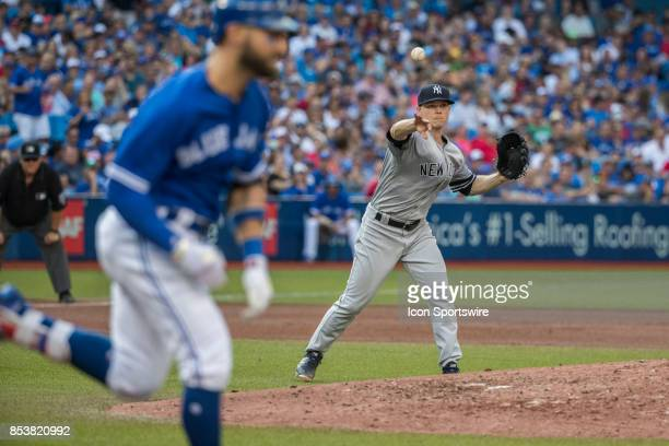 New York Yankees Starting pitcher Sonny Gray fields and throws out Toronto Blue Jays Center fielder Kevin Pillar at first during the regular season...