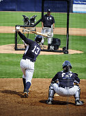 New York Yankees third baseman Alex Rodriguez flies out during an Intrasquad game played with a pitching machine pitching machine nicknamed 'Iron...