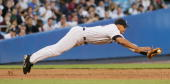 New York Yankees' third baseman Alex Rodriguez makes a diving stop on a ball though the runner was called safe at first in the third inning of a game...