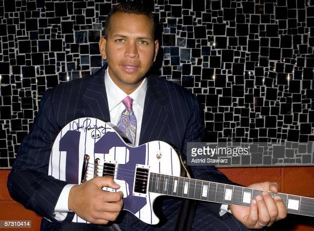 New York Yankees third baseman and 2005 American League Most Valuable Player Alex Rodriguez accepts a custom Gibson Guitar at Gotham Magazine's...