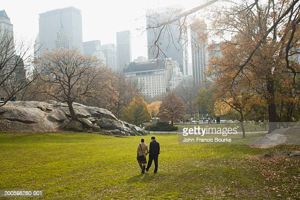 USA, New York, young couple walking in Central Park