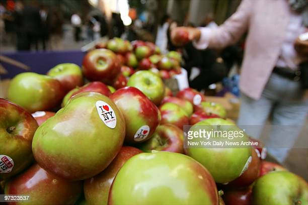 New Yorkers grab complimentary 'I Love New York' stickered apples outside Grand Central Terminal where Gov Eliot Spitzer announced the state's...
