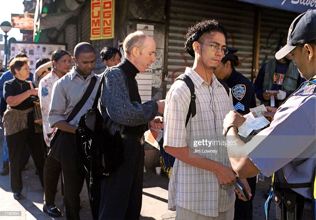 New Yorkers line up to present police with identification September 17, 2001 in order to return to work below Canal Street on the first day lower Manhattan was open for business since the terrorist attack on the World Trade Center in New York City.