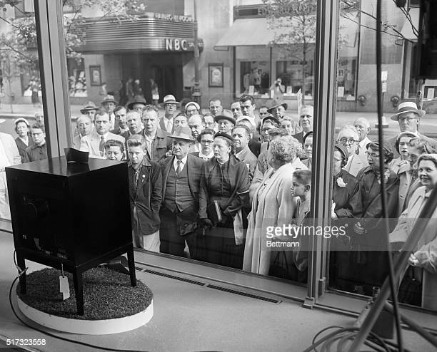 New Yorkers watching the Coronation of Queen Elizabeth on a display television