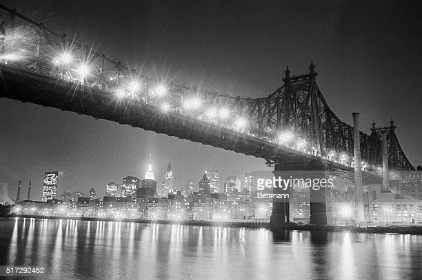 Manhattan's bright lights reflect on the East River below the Queensboro Bridge It was a year ago Nov 9 when this scene was darkened by the 'Great...