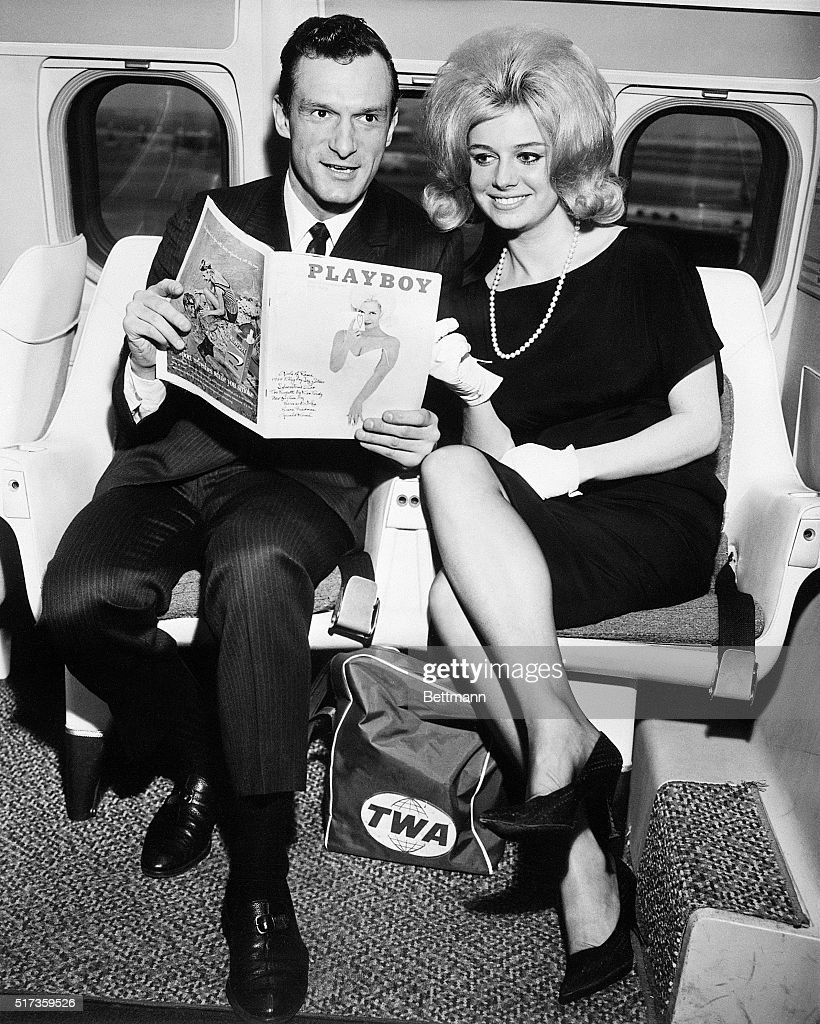 Hugh M. Hefner, Editor and Publisher of Playboy, is shown with Cynthia Maddox, the blond cover girl on the February issue of his magazine, arriving by TWA superjet from Chicago. They are here to attend a party given by Ella Fitzgerald at the Basin Street East in honor of winners of the Playboys jazz poll.