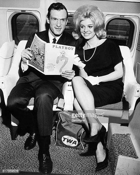 1/29/1962 New YorkNY Hugh M Hefner Editor and Publisher of Playboy is shown with Cynthia Maddox the blond cover girl on the February issue of his...