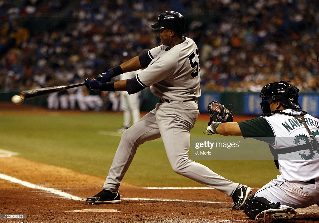 New York's <a gi-track='captionPersonalityLinkClicked' href=/galleries/search?phrase=Bernie+Williams&family=editorial&specificpeople=175814 ng-click='$event.stopPropagation()'>Bernie Williams</a> fouls off a pitch during Friday night's game between Tampa Bay and New York at Tropicana Field in St. Petersburg, Florida on July 7, 2006.