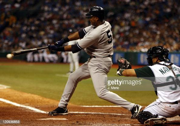 New York's Bernie Williams fouls off a pitch during Friday night's game between Tampa Bay and New York at Tropicana Field in St Petersburg Florida on...