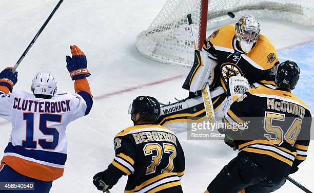 New York's Cal Clutterbuck beats Boston Bruins goalie Jeremy Smith late in the third period with the goal that won the game putting the New York...