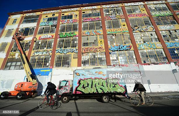 New York's graffiti iconic spot '5Pointz' stands defaced with white paint covering most of the art work after the building was painted white in New...