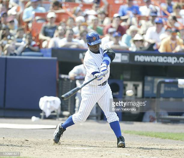 New York's Lastings Milledge drives the ball versus Baltimore at Shea Stadium June 18 2006 Wright was ruled safe The Mets defeated the Orioles 94