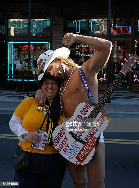 New York's Naked Cowboy greets a fan on the street on January 30 2009 in Tampa Florida NFL Fans from across the country are descending on Tampa ahead...