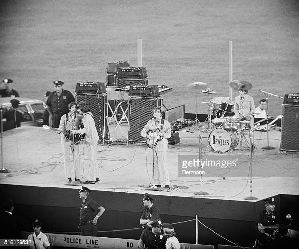 That's them The Beatles They're here In New york What they doing Entertaining Who they entertaing About 45000 screaming fans Where At Shea Stadium...