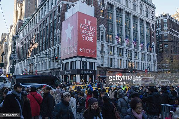 crowds of people Move past Macy's during Black Friday super sale shoppers in New York New York USA