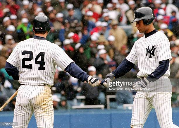 New Yrok Yankees' Derek Jeter is greeted at plate by Tino Martinez during home opener against Kansas City Royals