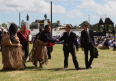 New Zealand acting Prime Minister Bill English is thanked by locals after the State Funeral held for King George Tupou V at Mala'ekula on March 27...