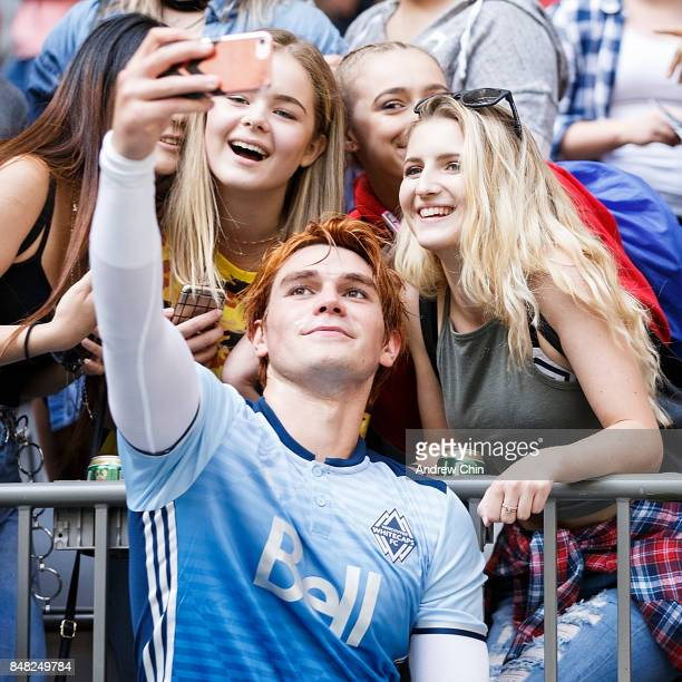 New Zealand actor KJ Apa takes a selfie with fans after the Legends And Stars Whitecaps FC Charity Alumni match at BC Place on September 16 2017 in...
