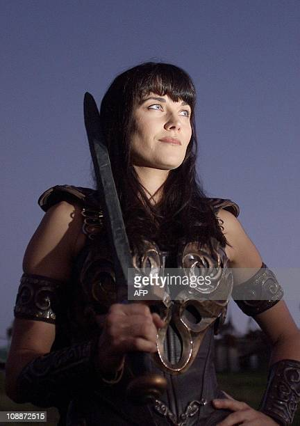New Zealand actress Lucy Lawless who plays the character 'Xena' stands on the set at dusk during the final night of filming for the last episode of...