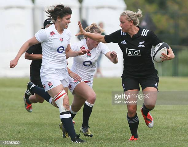 New Zealand advances the ball against England during the Women's Rugby Super Series at Red Deer Rugby Club on July 1 2015 in Red Deer Alberta Canada...