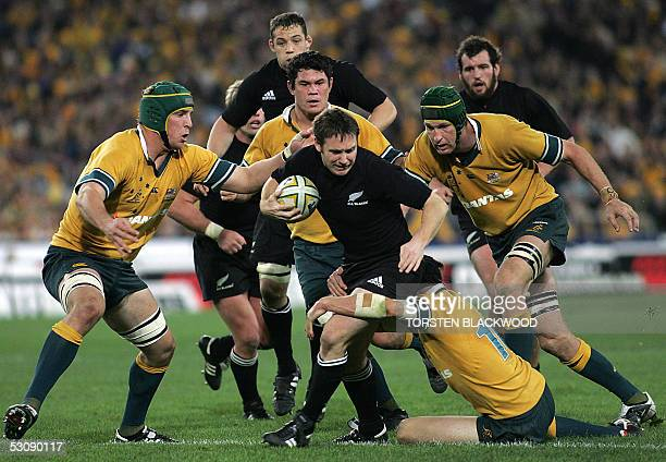 New Zealand All Black Andrew Mehrtens attempts to break through the Wallaby defence during the Bledisloe Cup Trinations rugby union Test at Telstra...