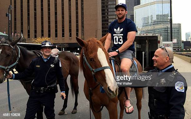 New Zealand All Black Captain Kieran Read sits on a horse from the Chicago Police Department Mounted Patrol Unit on October 30 2014 in Chicago...