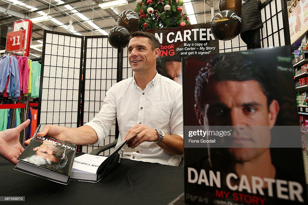 New Zealand All Black Dan Carter signs copies of his autobiography at The Warehouse in West City Shopping Centre on November 17 2015 in Auckland New...