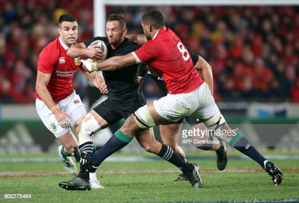 New Zealand All Blacks Aaron Cruden is tackled by British and Irish Lions Toby Faletau during their Test match between New Zealand and the British...