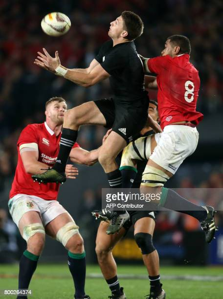 New Zealand All Blacks Beauden Barrett competes for the ball with British and Irish Lions Toby Faletau during their Test match between New Zealand...