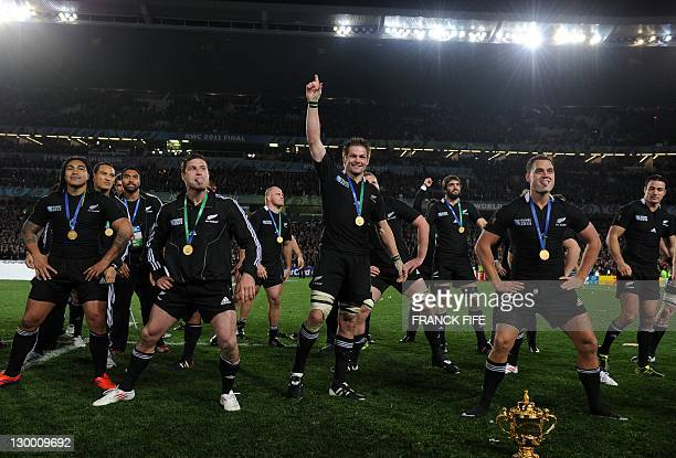 New Zealand All Blacks captain Richie McCaw and his team perform a victory Haka in front of the Webb Ellis Cup after the 2011 Rugby World Cup final...
